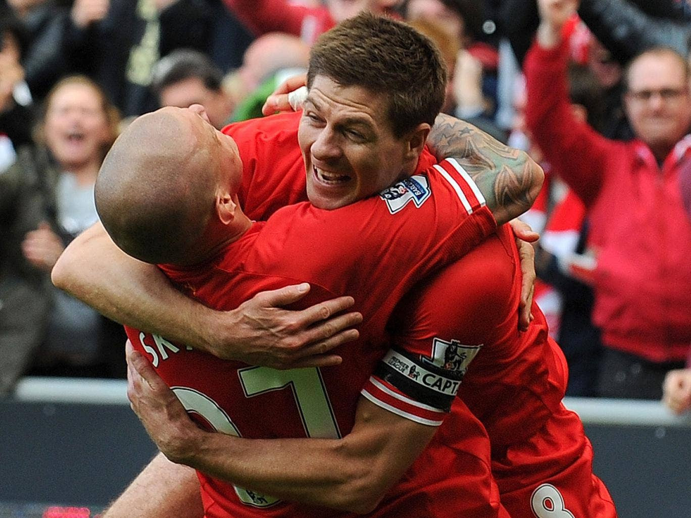 Steven Gerrard celebrates with Martin Skrtel after the defender made it 2-0 in the win over Manchester City